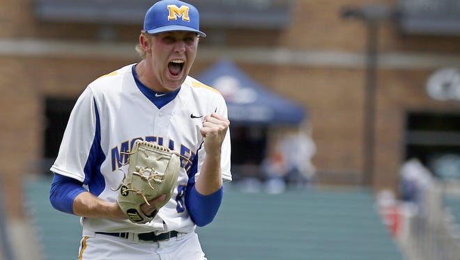 Moeller starting pitcher Nick Bennett pumps his first after the final out Thursday against Aurora.