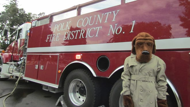McGruff the Crime Dog was among the visitors to Monmouth's National Night Out. Monmouth Police, Polk County Fire District No. 1 and CERT were among the hosts of the National Night Out block party held at Gentle Woods Park. Photo taken Tuesday, Aug. 7, 2012.