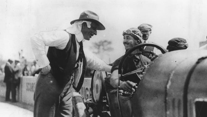Driver Jules Goux talks with Charles Faroux, a French sportsman who served as unofficial team manager for Peugeot during the 1913 Indianapolis 500.