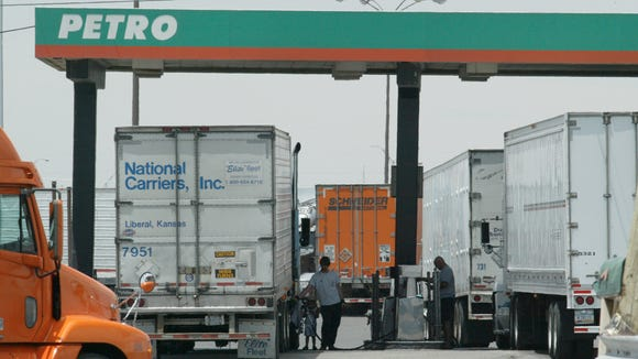 Long-haul truck drivers fill their tanks with diesel fuel at the Petro truck stop along Interstate 10 at Horizon Boulevard.