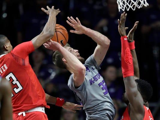 Texas Tech guard Jarrett Culver (23) blocks a shot by Kansas State forward Dean Wade (32) during the first half of an NCAA college basketball game in Manhattan, Kan., Saturday, Feb. 10, 2018. (AP Photo/Orlin Wagner)