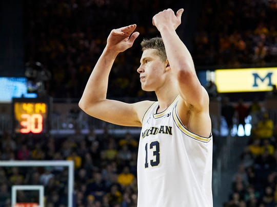 Michigan forward Moritz Wagner (13) fires up the crowd during the second half of U-M's 76-73 overtime win on Saturday, Feb. 3, 2018, in Ann Arbor.