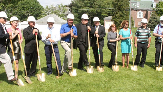Dignitaries take part in the groundbreaking for the new parish center for St. Mary's Church in Grinnell on Monday, May 15.