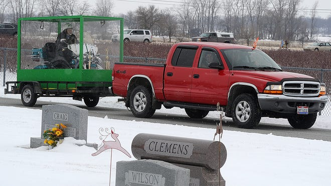The family of Billy Standley, of Mechanicsburg, Ohio, carried out his wish to be buried on his 1967 Harley Davidson motorcycle Friday, Jan. 31, 2014, hauling a large Plexiglas casket to Fairview Cemetery in Crawford County, Ohio.