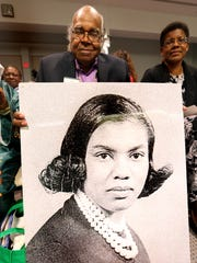 "John Due holds a large photo of his wife Patricia Stephens-Due who was among those who were arrested and held in the Leon County jail for 49 days.  A ceremony was held in Tallahassee's City Hall celebrating the new ""Footsteps to Freedom"" commemorative sidewalk  Monday. The segment of sidewalk on Jefferson Street pays tribute to the 1956 bus boycott and 1960 lunch counter sit-ins that took place in Tallahassee. City and county commissioners honored the 58 people memorialized in the sidewalk before a standing room only crowd."