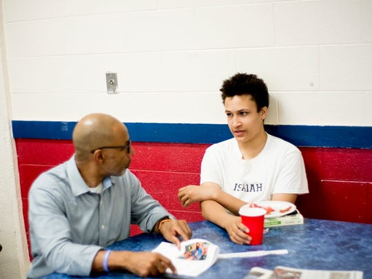 Mentor Frank Benefield with his student Isaiah at the Big Brother Big Sister club meeting at South-Doyle High School in Knoxville, Tennessee on Thursday, May 17, 2018. This group is part of the Big Brother Big Sister Mentor 2.0 program.