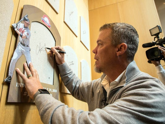 Hall of Fame inductee and former Atlanta Braves slugger Chipper Jones signs the spot where his Hall of Fame plaque will hang during an orientation tour of the National Baseball Hall of Fame in Cooperstown, N.Y., Tuesday, April 10, 2018. Jones toured the Hall of Fame to prepare for his induction this summer when he will be inducted along with Jim Thome, Vladimir Guerrero, Trevor Hoffman, Alan Trammel and Jack Morris. (Milo Stewart Jr./National Baseball Hall of Fame and Museum via AP)