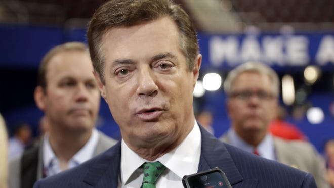 In this July 17, 2016 file photo, then-Donald Trump campaign chairman Paul Manafort talks to reporters on the floor of the Republican National Convention, in Cleveland.