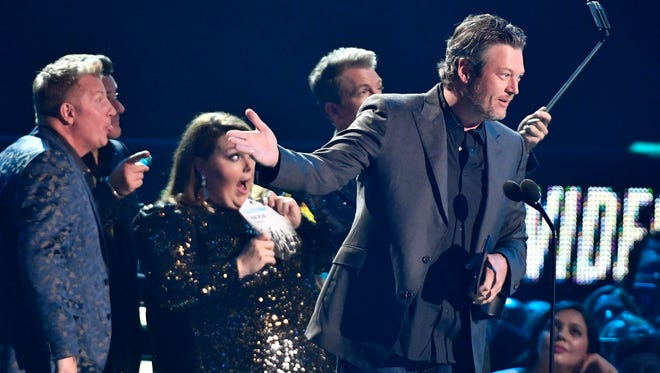 Blake Shelton accepts the Male Video of the Year award as Chrissy Metz and Rascal Flatts take a selfie at the 2018 CMT Awards Wednesday, June 6, 2018, at Bridgestone Arena in Nashville, Tenn.