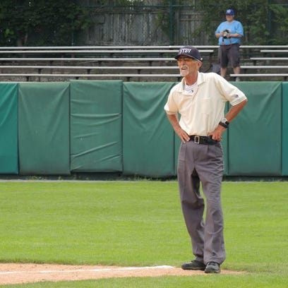 Dale Shuck umpires a game at Doubleday Field in Cooperstown,