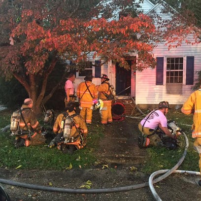 Firefighters work at the scene of a Salisbury fatal