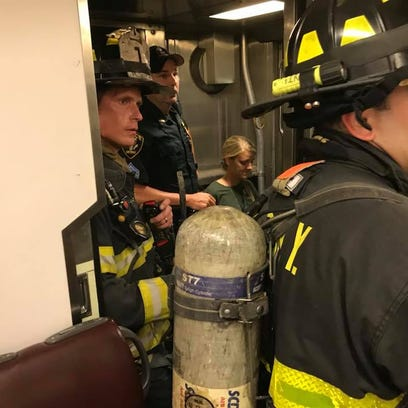 New York firefighters inside an NJ Transit train that