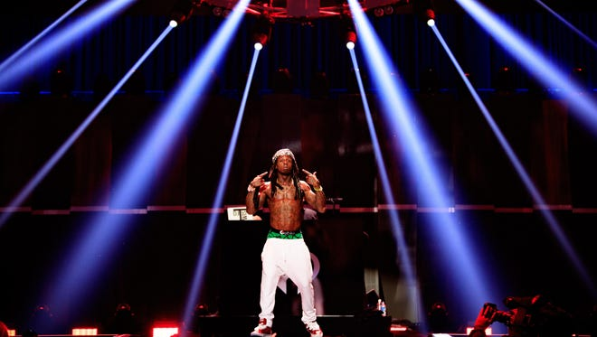 Lil Wayne performs onstage at the 2015 iHeartRadio Music Festival at MGM Grand Garden Arena on September 18, 2015 in Las Vegas, Nevada.