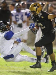 """Xavier Prep""""s Adam Gil runs for yardage during a home game against Cathedral City High School on September 29, 2017,"""