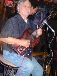 Col. Bruce Hampton is shown playing one of his many
