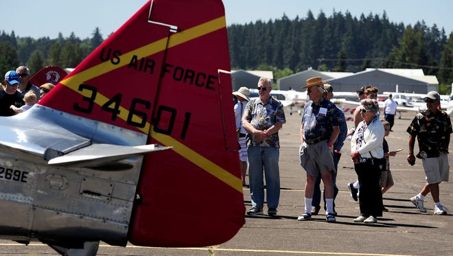 "Visitors check out a T-6 training plane during the 2015 ""Warbirds Over The West"" event at Salem Airport's McNary Field. This year's event is Saturday, June 11, from 9 a.m. to 6 p.m."