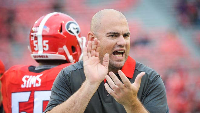 Georgia offensive line coach Rob Sale encourages players as he watches warm ups before an NCAA college football game against Kentucky, Saturday, Nov. 7, 2015, in Athens, Ga. Georgia won 27-3.