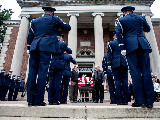 Captain Nathan Richeson's brother, Joel, and father, Doug, carry his casket from Swasey Chapel on Tuesday afternoon.