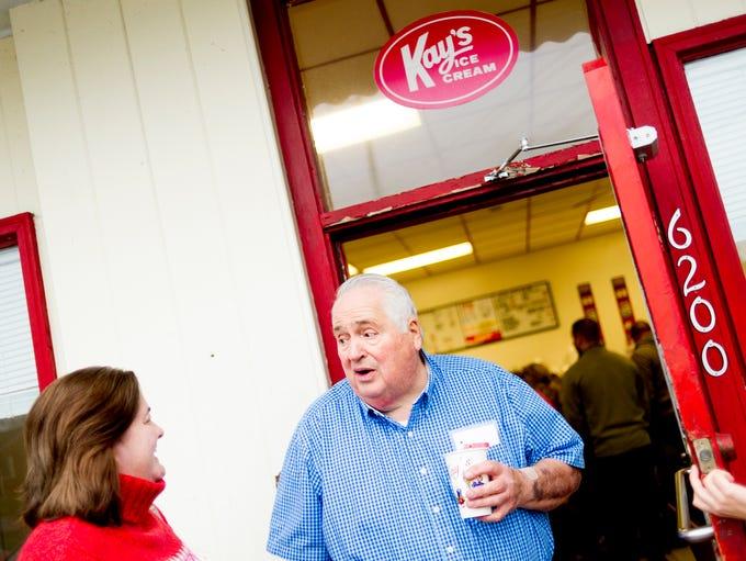 Owner Jim Brackett speaks with a customer telling her