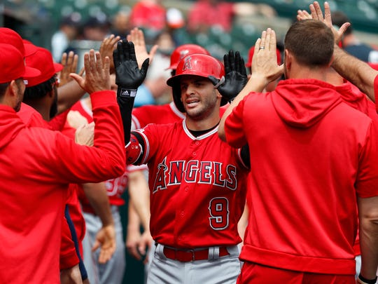 Los Angeles Angels' Tommy La Stella (9) celebrates with teammates after hitting a two-run home run in the second inning of a baseball game against the Detroit Tigers in Detroit, Thursday, May 9, 2019. (AP Photo/Paul Sancya)