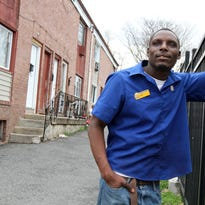 Daniel Bellamy of Asbury Park, who sings during his work shifts at Auntie Anne's in the Monmouth Mall, stands outside his apartment in Asbury Park on April 14.