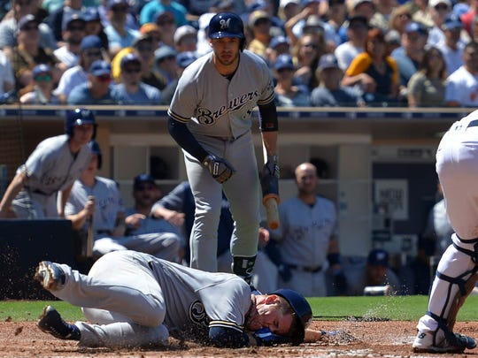 The aftermath of Anderson's slide is apparent on his face and Ryan Braun's.
