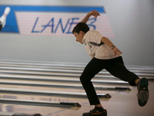 Adam Gelvan of Montville bowls in the Morris County