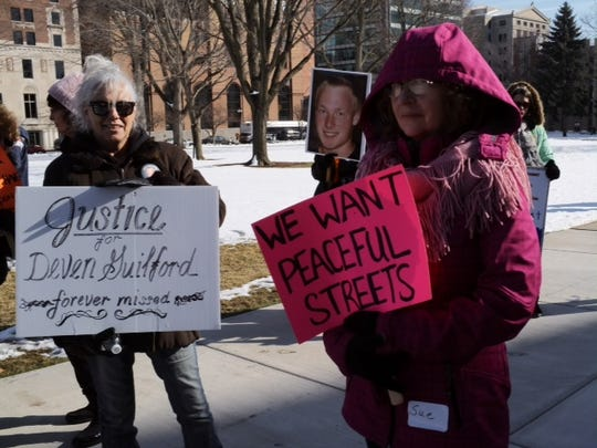 Kimber Watson left, neighbor and Susanne Vedder, cousin attend a rally for Devin Giulford along with over 100 other people Saturday.