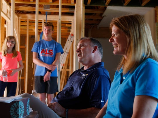 Bill and Juanita McCann talk about Bill's condition, his ALS diagnosis and the help they are receiving from friends and the community Thursday, May 18, 2017, in their home near St. Johns. Annaliza, 10, and Luke, 16 listen.