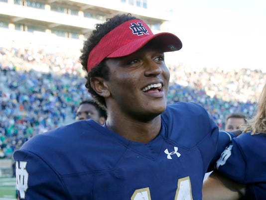 FILE - In this Sept. 10, 2016, file photo, Notre Dame quarterback DeShone Kizer (14) smiles after Notre Dame's 39-10 win over Nevada in an NCAA college football game, in South Bend, Ind. Kizer declared for the NFL draft Monday, Dec. 12, 2016. The 6-foot-4, 230-pound Kizer could end up being the first quarterback selected in the draft in April. (AP Photo/Charles Rex Arbogast, File)
