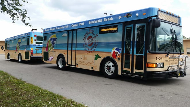 Replacing the green trolleys used in the beach shuttle's inaugural run this year, the newly christened Beach Bus vehicles stand out with colorful beachscapes.