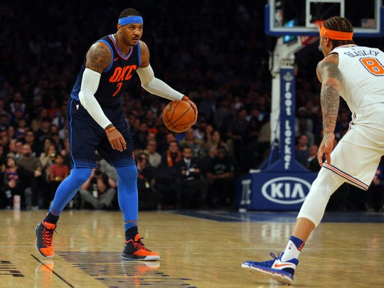 Oklahoma City Thunder power forward Carmelo Anthony (7) controls the ball against the New York Knicks during the first quarter at Madison Square Garden on Saturday, Dec. 16, 2017.