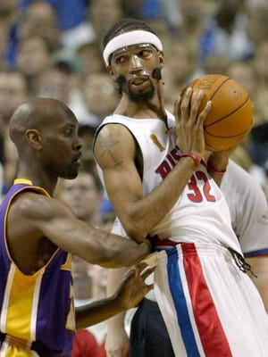 Pistons guard Richard Hamilton sizes up the defense of Lakers guard Gary Payton in Game 5 of the NBA Finals on June 15, 2004 at the Palace.