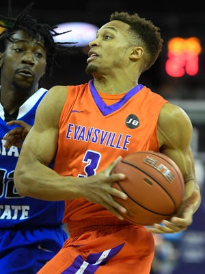 Evansville's Jaylon Brown drives to the basket against pressure from Indiana State's Laquarious Paige as the University of Evansville hosts Indiana State at the Ford Center Saturday, February 25, 2017.