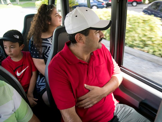 Elmer Chicas, right, and his son Joshua, 7, and daughter, Keiry, 15, take a ride on Nickel Ride in downtown Fort Myers on Wednesday.