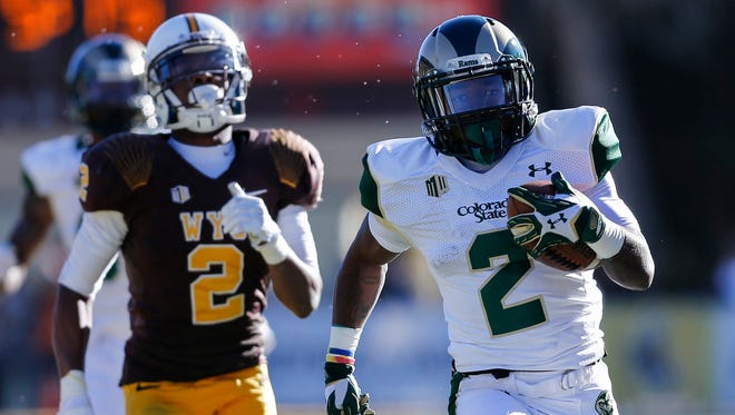 CSU receiver Deionte Gaines, shown  running away from Wyoming defender Robert Priester during a game last season in Laramie, Wyo., said Friday that he's leaving the Rams to continue his football career 'elsewhere.' Gaines was dismissed from the CSU team during spring practices for undisclosed reasons.