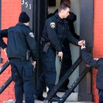 Police investigate houses along S. George St. after a morning shooting in the 200 block of S. Queen St. Thursday, Feb. 11, 2016. Bill Kalina photo