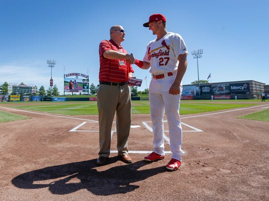 St. Louis Cardinals catcher Andrew Knizner shakes hands with Springfield Cardinals General Manager Dan Reiter when Knizner played for Springfield in June 2017.