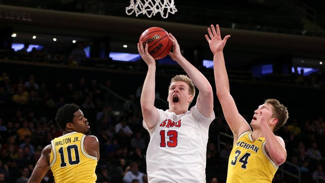 SMU forward Harry Froling (13) drives to the basket during the first half of the 2K Classic championship game at Madison Square Garden.