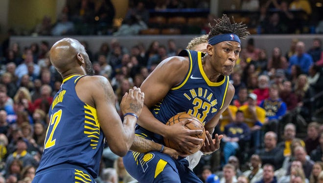 Jan 6, 2018; Indianapolis, IN, USA; Indiana Pacers center Myles Turner (33) rebounds the ball in the first half of the game against the Chicago Bulls at Bankers Life Fieldhouse. Mandatory Credit: Trevor Ruszkowski-USA TODAY Sports