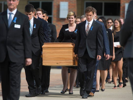 Pallbearers carry the casket of Otto Warmbier on June