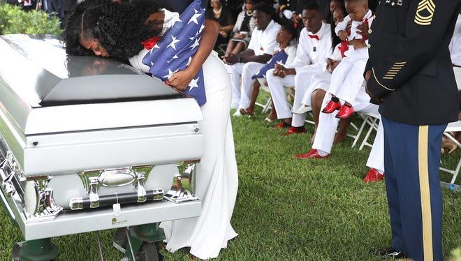 Myeshia Johnson kisses the casket of her husband,  Sgt. La David Johnson, in Hollywood, Fla., on Oct. 21, 2017.