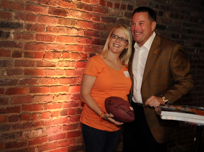 UT football coach Butch Jones takes a photo with Drue Allison during the Big Orange Caravan at The Factory Tuesday, May 6, 2014, in Franklin, TN.