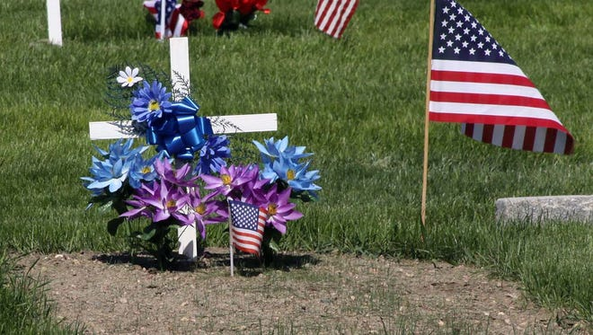 Flowers and flags mark graves in Lakeview Cemetery in honor of Memorial Day in this file photo.