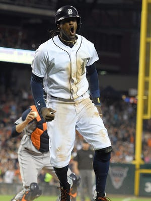 Detroit Tigers' Cameron Maybin celebrates after scoring  a run in the sixth inning after Astros second baseman Jose Altuve dropped a pop fly off the bat of Miguel Cabrera in shallow right field with two outs, in a baseball game Saturday, July 30, 2016, in Detroit.
