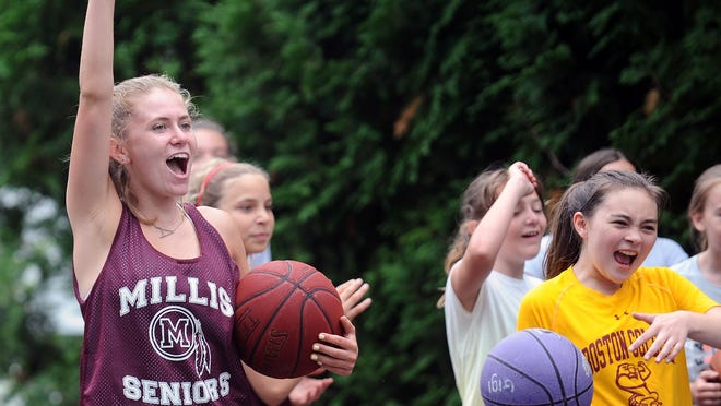 Millis High School rising senior and basketball player Abby Miller cheers on campers at the EA Backyard Ball skills and drills camp for incoming 5th, 6th, and 7th graders that she and Eryn Rice lead at Miller's home court.