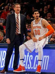 Knicks head coach Jeff Hornacek looks on with center Enes Kanter against the Los Angeles Lakers during the first half at Madison Square Garden.