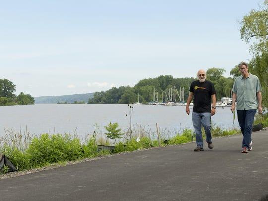 Jeff Furman of Ithaca, left, and former Ithacan, Tom Terrizzi, now living in Albany, walk on the Cayuga Waterfront Trail overlooking the Cayuga Inlet.
