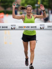 Laura Lunardi of West Chester is first female to cross the finish line in the Delaware Marathon.