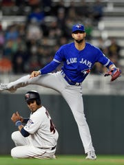 Gregorio Petit of the Minnesota Twins is out at second base as Lourdes Gurriel of the Toronto Blue Jays turns a double play during the seventh inning May 1, 2018 at Target Field in Minneapolis. The Jays won 7-4 in 10 innings.